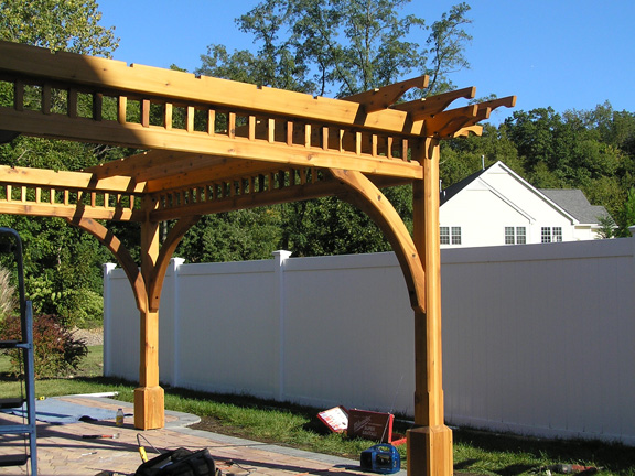 Baldwin Pergolas may be able to install your pergola depending on where you are.