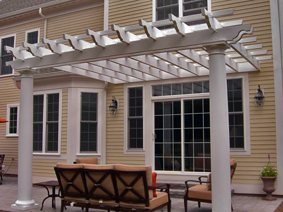 This image shows an attached fiberglass pergola